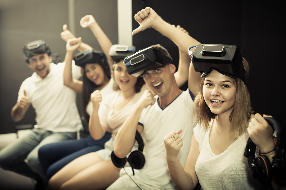 people using virtual reality glasses delighted with videogames and new tech
